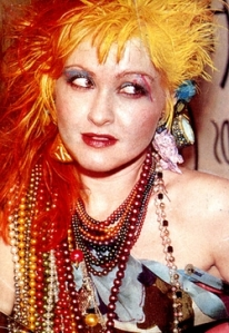 Cyndi Lauper in the 1980s shows the obvious contract of styles going on in the decade