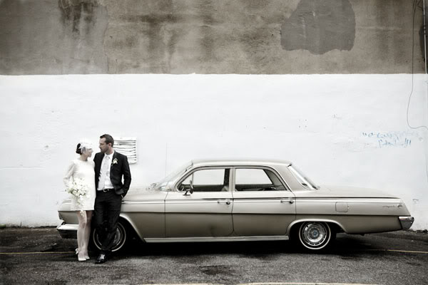 http://media.photobucket.com/image/weddings%20with%20vintage%20car/snippetandink/Real%2520Weddings/Nicole%2520and%2520Anthony/12-vintage-getaway-car.jpg